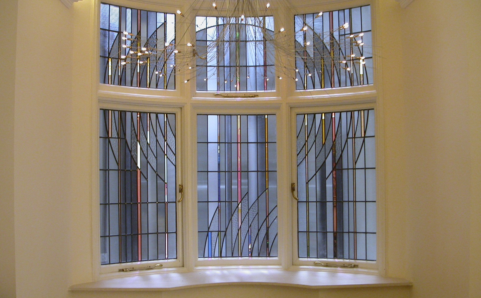 Art Deco Stained Glass Window to enhance light and screen view on light-well on mansion block apartment