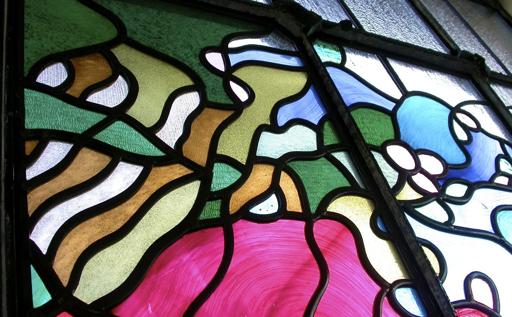 Section stained glass - greens and pinks