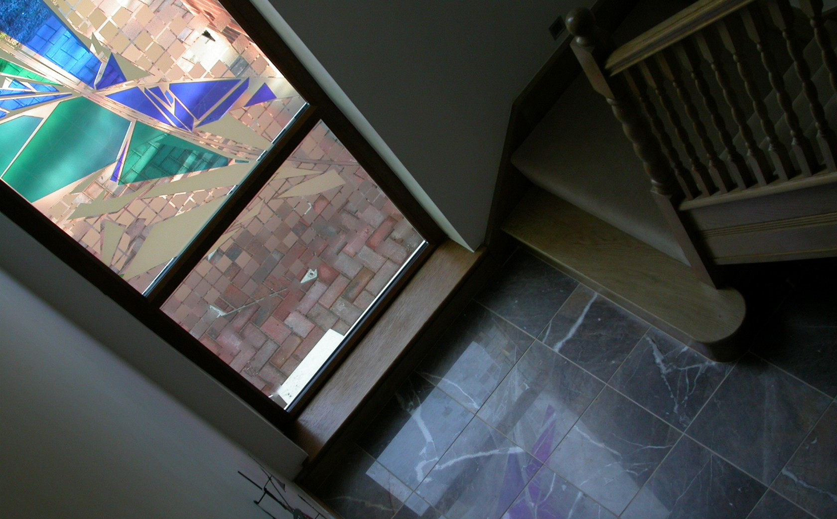 Two-Storey stairway glass art installation. View from upstairs