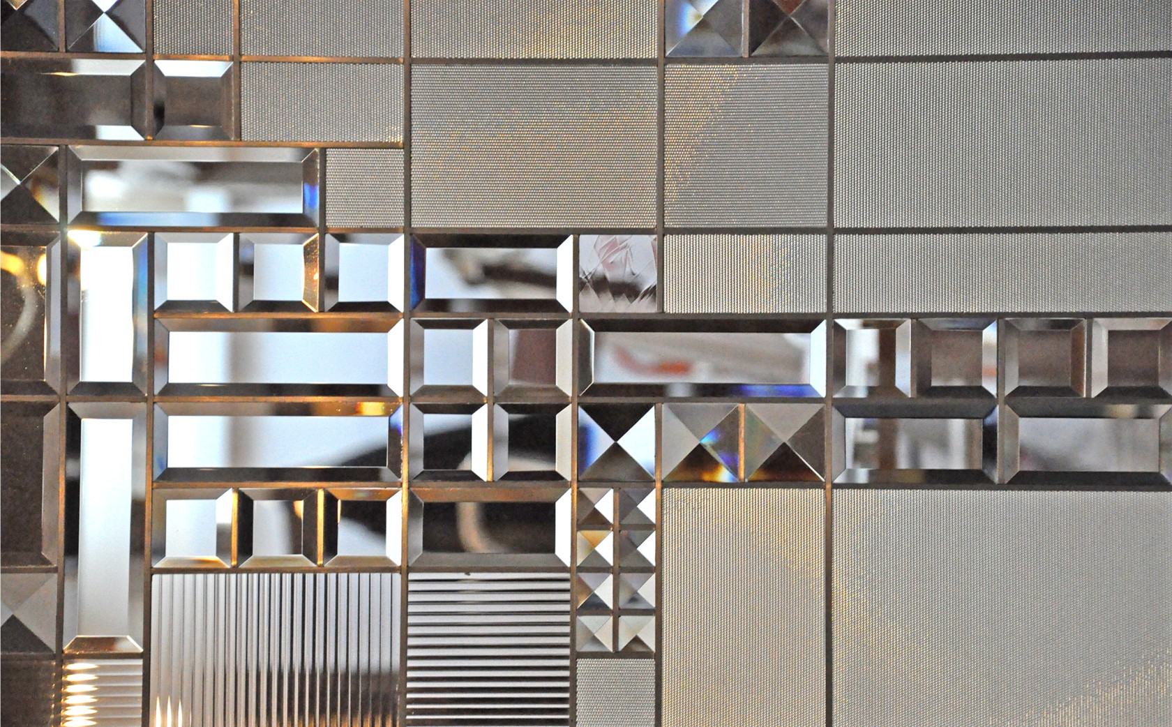 Structural glass systems reflect historic decorative elements translated into a contemporary functional idiom.