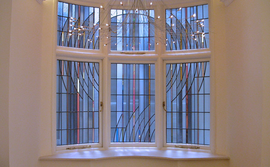 Site specific stained glass for light maximisation and screening