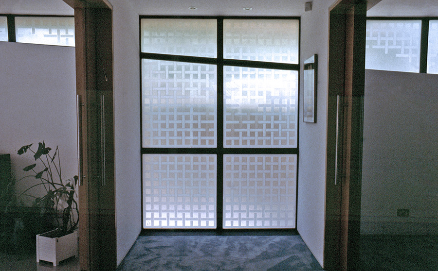 Interplay of varying acid-etching white tones and erosion into clear areas in the upper sections, paralleling the natural movement of light and the privacy issue